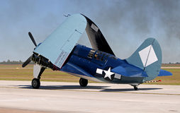 Old navy figher airplane. World War II era navy fighter airplane taxiing Royalty Free Stock Image