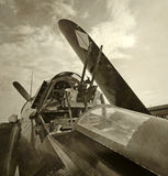 Old navy fighter. World War II era fighter plane with folded wings Royalty Free Stock Image