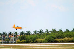 Old Navy plane lands. Old US Navy airplane about to land. 1957 Beech D-45 (T-34 Mentor) by Walter Beech. 2014 Memorial Day, Miami Stock Image