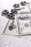 Old necklaces and money Royalty Free Stock Photo