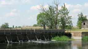 Old needle weir at Havel river in summer. Small side arm of mainriver flowing through Havelland (Brandenburg, Germany).  stock video