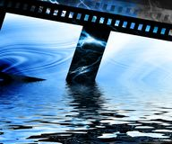 Old negative film strip. Rising from the water Royalty Free Stock Photography