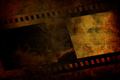 Old negative film strip. On a dark background Royalty Free Stock Photography