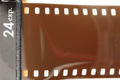 Old negative filmstrip. The old and dirty negative filmstrip represent the photography and camera support equipment concept related idea Stock Photography
