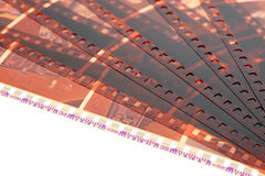Old negative 35mm film strip on white background. Old negative 35 mm film strip on white background, strip of tangled camera film - place for copy and space text stock images