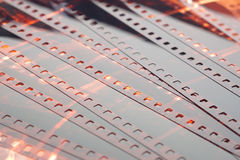 Old negative 35mm film strip on white background. Old negative 35 mm film strip on white background, strip of tangled camera film - place for copy and space text stock photography