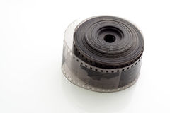 Old negative 35 mm film strip on white background Royalty Free Stock Photo