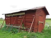 Old neglected corn crib loses its balance stock photos