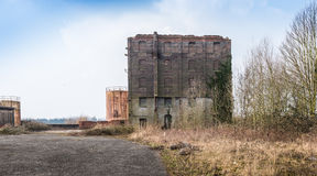 Old and neglected factory building in a desolate area Royalty Free Stock Image