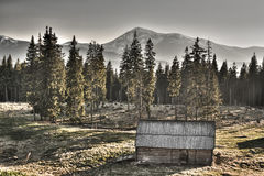 The old neglected house is in the high mountains Stock Photos