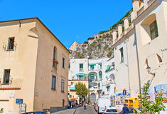 The old neighborhood. AMALFI, ITALY - OCTOBER 5, 2012: The old residential neighborhood with the pastel colored houses is sandwiched between the rocks and Stock Photos