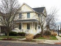 Old Neighborhood Yellow House on Corner Stock Photo