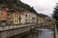 Old neoclassical buildings by the river in Florina, Greece Stock Photos