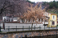 Old neoclassical buildings by the river in Florina, Greece Stock Image