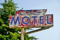 Old Neon Painted Motel Sign with Arrow on Tall Metal Pole Stock Image