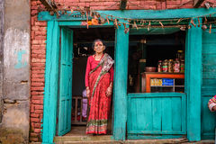 Old nepalese lady sells goods in her store Stock Images