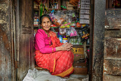 Old nepalese lady sells goods in her store, Kathmandu, Nepal Royalty Free Stock Photos