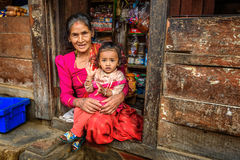 Old nepalese lady sells goods in her store, Kathmandu, Nepal Royalty Free Stock Photo