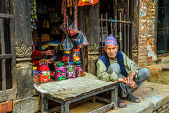 Old nepalese man and his wife sell goods in their store Royalty Free Stock Photography