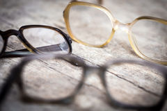Old nerdy hornrims or eye glasses on wooden table Royalty Free Stock Photo