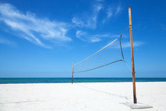 Old net for beach volleyball on sea coast Royalty Free Stock Photos