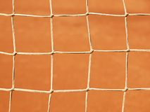 Old net with the ground and white line tennis court. Dry red clay. Light red crushed bricks surface on outdoor tenn Royalty Free Stock Photos