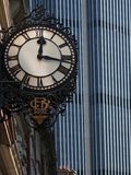 Old and New. An old 19c clock face against a modern tower block - this one in London Royalty Free Stock Photos