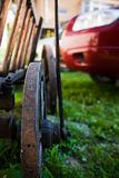 Old & New. Detail of and old traditional cart compared to a 2007 modern SUV stock photo