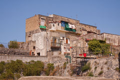 Old And New. A modern-day structure built on the ruins of Herculaneum in the Bay of Naples, Italy Royalty Free Stock Photos