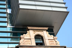 Old And New. New Office Building Built Over A Very Old Building Royalty Free Stock Photography
