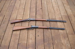 Old and new. Two generations of winchester 30/30 model 1894 and 1998 royalty free stock photography
