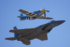 Old and New. P-51 and F-16 fly side by side at an airshow stock photos