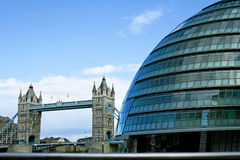 Old and new. Old Tower bridge and new city hall contrast Stock Photography