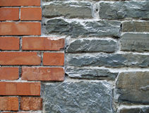 Old and New. Brick wall showing old grey bricks and red new bricks in an abstract pattern Stock Photo