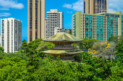 Old and New. Ancient temple with modern Honolulu skyline in the the background Stock Images