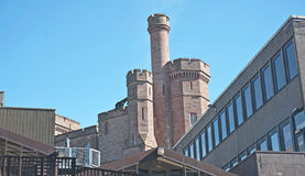 Old and new architecture. Detail of historic Inverness Castle with towers and turrets side by side with modern building Royalty Free Stock Photos