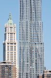 Old and new architecture in New York City. The ornate old Woolworth Building stands next to the new modern Gehry building, Beekman Tower, in Manhattan in New royalty free stock image