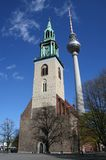 Old and New in Berlin. Contrasting image of an old church with a modern television tower in Berlin, Germany Stock Photos