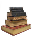 Old on New Bibles. New bible sitting below a stack of antique bibles Stock Image