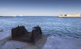 Old and new. Bickering big ship in the entrace of the old harbor of Valletta, Malta Stock Image