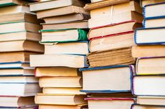 Books stacked. Piles of books background. Royalty Free Stock Photo