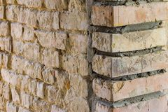 Old and new brickwork. Retro grunge construction building royalty free stock image