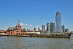 Old and New Building nearby Liberty State Park Jersey City. Central Railroad of New Jersey Terminal on the left and modern skyscraper on the right Royalty Free Stock Photography