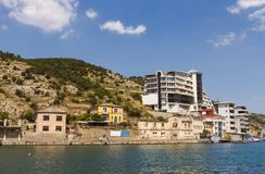 Old and new buildings on the banks of the picturesque Balaklava Bay in the Crimea.  stock photography