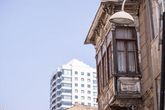 Old and new buildings. Izmir - Turkey, August 18,2015: Old and new buildings in the same picture Stock Image