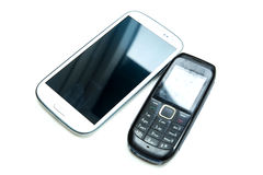 Old and new cellphones royalty free stock photo