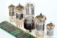 Old and new electronic components. Old and new electronics components royalty free stock photo