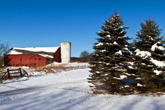Old New England barn. Characteristic New England barn with silo on a crisp winter day Royalty Free Stock Photography