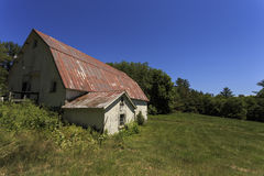 Old New England Barn. An old white barn with tin roof Stock Photography