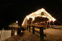 Old new england covered bridge with church at night #2. An old new england covered bridge in northern new hampshire with a church at night with lights. #2 royalty free stock photography